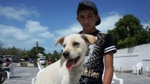 Chixculub Youth with Puppy at AFAD Clinic