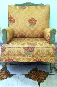 Upholstered chair and mosaic tile in Merida